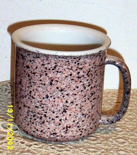 A Set Of Six Mugs In Pink With Charcoal Gray Specks