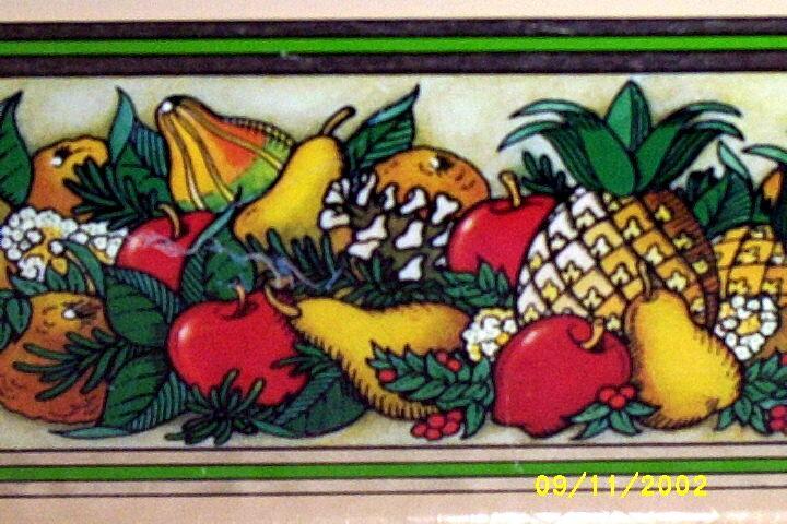 Pyrex Rectangular Loaf Pan Inserted In An Assorted Fruit Patterned Tin  Teleflora Holder