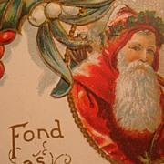 Early 1900's Embossed Christmas Postcard Framed Santa, Holly Leaves & Berries