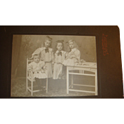Early 1900's Studio Matted Photograph 4 Siblings Children Bows, Curls, High Top Shoes