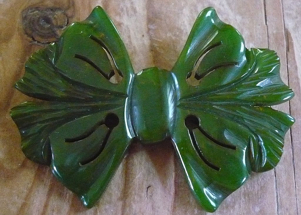 Carved Green Bakelite Bow Pin