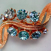 Rhinestone Swirl Brooch with Blue Stones