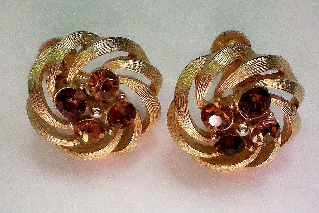 Signed Lisner Gold Tone Amber Rhinestone Swirl Earrings