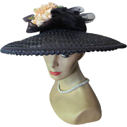 Sophisticated Black Straw Hat Picture Style with Open Work and Clutch of Peach Roses Mid-Century