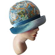 Rolled Brim Cloche Hat in Teal Velvet and Avocado, Orange and Silver Feathers by Sandra New York