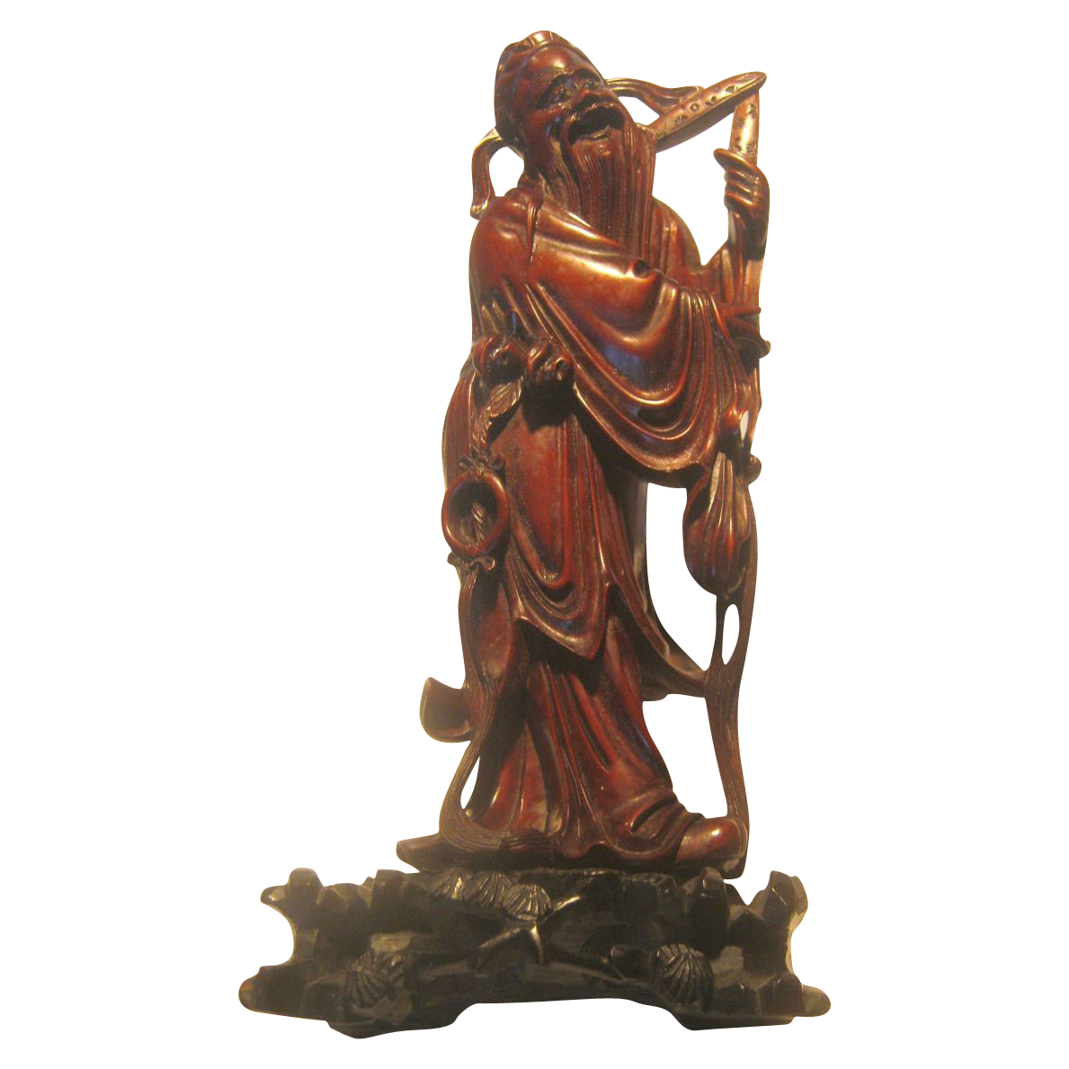 An Old Carved Wood Statue of an Immortal.