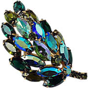Floral domed rhinestone brooch blue-green shades