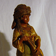 A 18 th Century hand Painted Pottery Figurine 'Maiden with Lute'