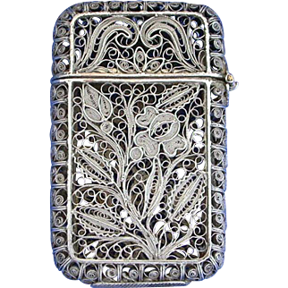 Silver filigree match safe, intricate floral designs