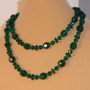 "Green Glass Beads – Assorted sizes - 36"" long."