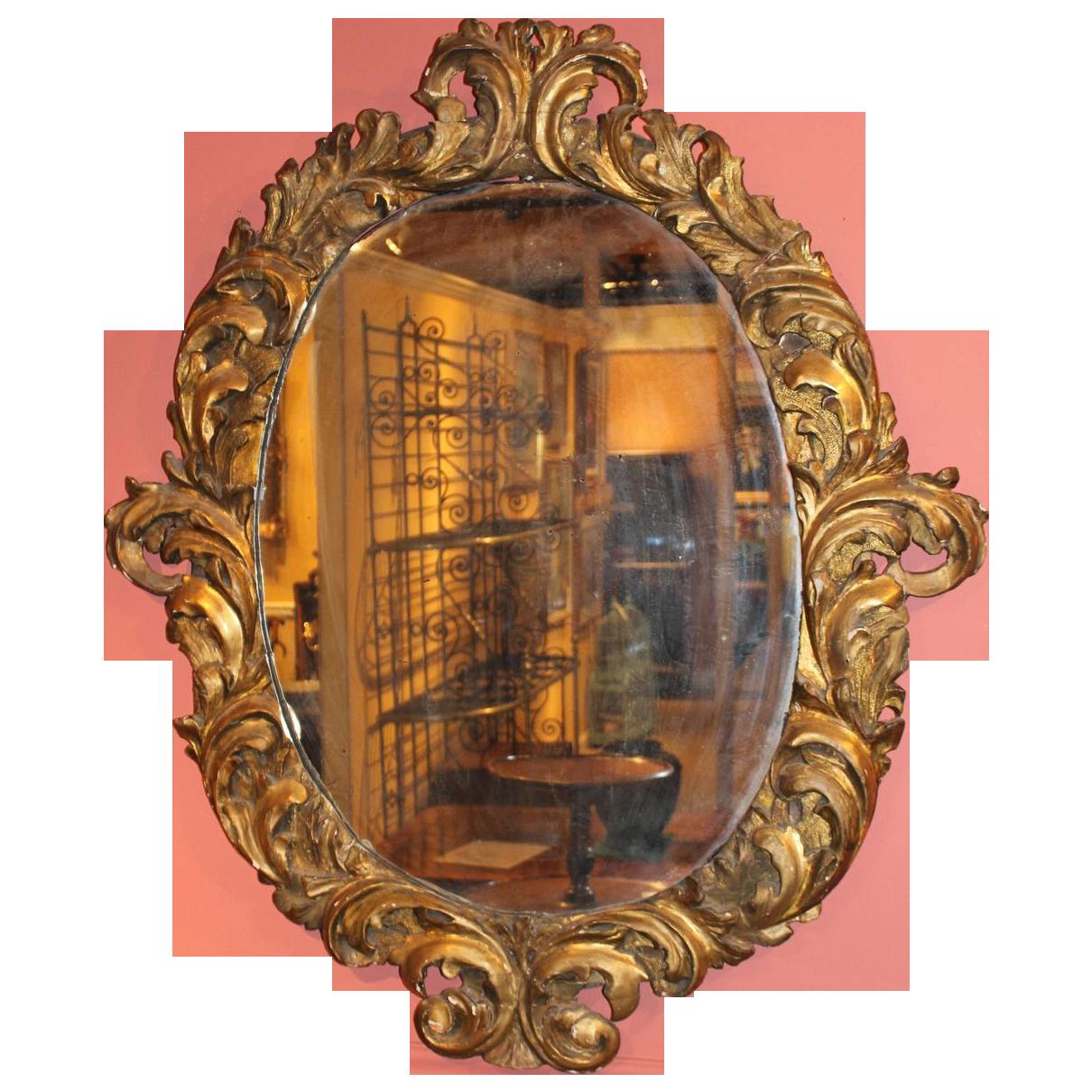 Large 18th c italian baroque oval gilt wood mirror from for Italian baroque mirror