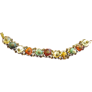Miriam Haskell Bracelet with Multi Color Stones Filagree Metal Base Signed