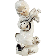Old, Porcelain Angel Playing an Instrument