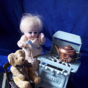 Tiniest Jointed Glass Eyed Teddy and Cast Metal Chair
