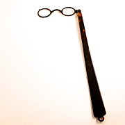 1910 Tortoiseshell Lorgnette with 11 inch handle.