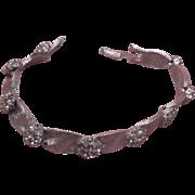 Signed Trifari Clear Rhinestone Brushed Silver Tone Ribbon Link Bracelet