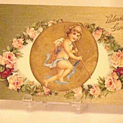 Wonderful 1908 Embossed Valentine Greeting Postcard Cupid With Bow And Arrow Inset With Pink Roses