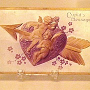 Beautiful 1908 Embossed Cupid's Message Postcard Gold Arrow Through Gold Cupids And Purple Heart