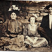 RPPC Real Photo Postcard Mother Father Daughter In Their Sunday Best Sitting Against Stone Wall