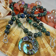 Necklace With Ocean Blue And Green Swirl Pendant Suggestive Of Abalone