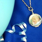 A Personalized Sterling Silver Filigree Round Photo Locket On A Delicate Sterling Silver Chain