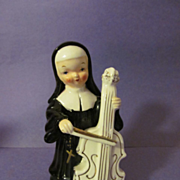 Ardalt Nun Playing Cello Musical Instrument