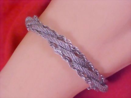 50% Off - GOLDETTE OF NEW YORK Silver Tone Braided Three Strand Rope Mesh Bracelet/w Safety Chain