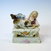 Conte and Boehme porcelain match holder striker dog on table