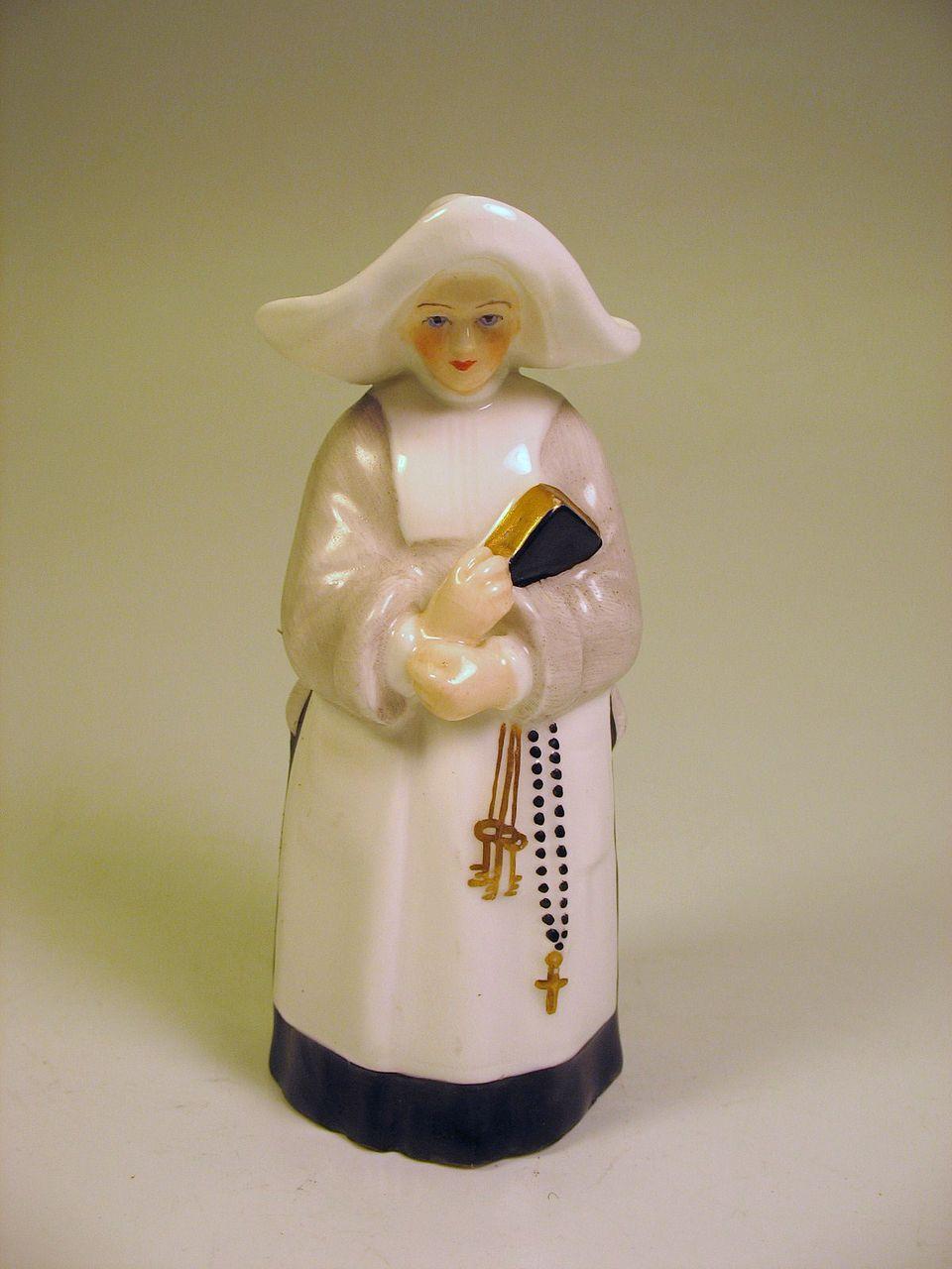 1880's Royal Worcester porcelain figural candle snuffer