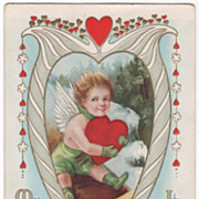 Cupid on Sled with Large Red Heart Lyre Frame Valentine Vintage Postcard