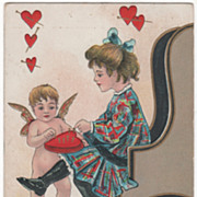 Artist Signed H B Griggs Cupid and Girl Pushing Pins in a Heart Pin Cushion Vintage Valentine Postcard