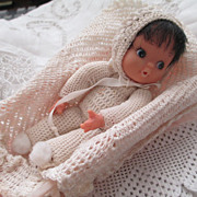 Adorable Vinyl Baby Dressed in Fine Crochet/Crib and Covers