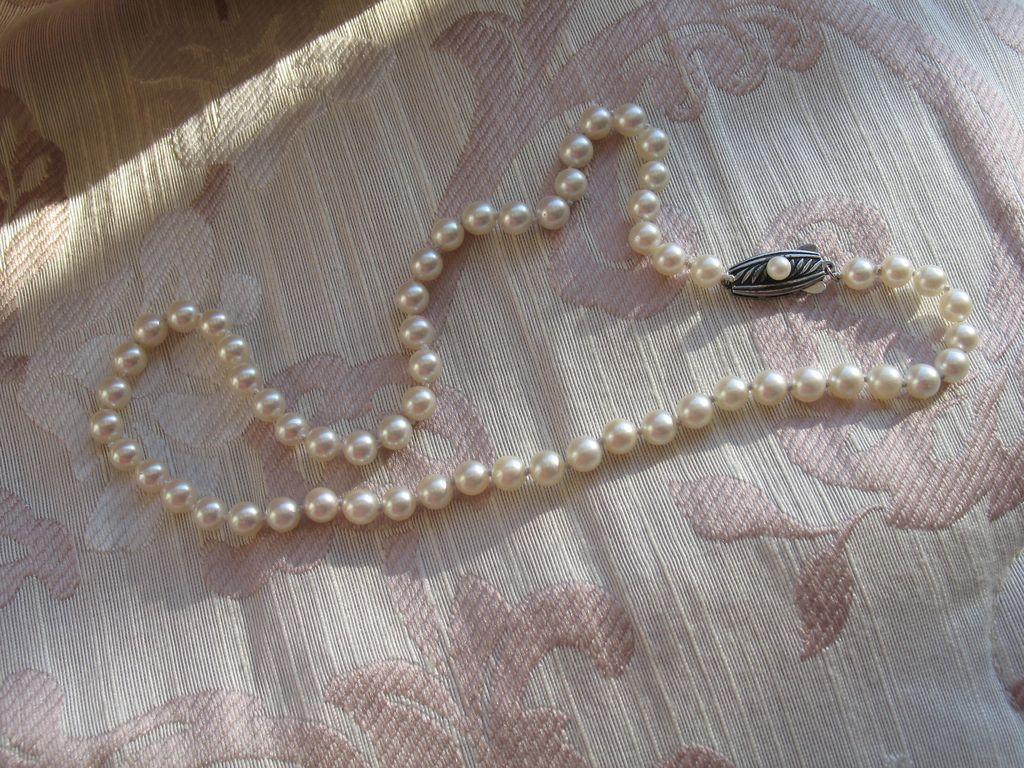 Circa, 1950s.  MIKIMOTO, Vintage Mikimoto Cultured Pearl Necklace in Silver Clasp.