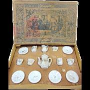 Very small miniature German white & gold antique doll tea service in the original box
