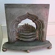 Antique cast metal miniature sample fireplace