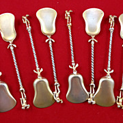 Unusual set of eight 800 silver dessert spoons