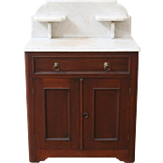 Antique marble top wash stand cabinet, American C.1880.