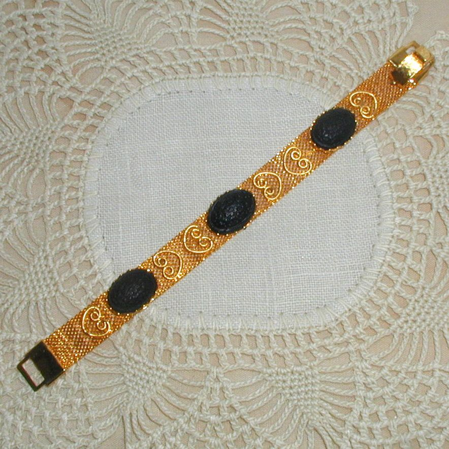 Gold-tone Mesh Bracelet with Black Floral Glass Cabochons