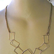 Mod Copper square link rings on cable long necklace