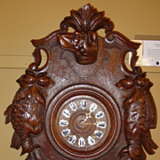 Superior French Black Forest wall clock---carved dog
