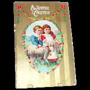 """A Joyful Easter"" Boy & Girl with Lamb or Ewe Postcard - Marked"