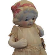 Darling All Bisque With Molded Pink Hair Bow