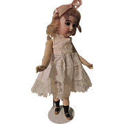 "Peaches & Cream 11"" German Bisque Head Doll with Walking Mechanism"