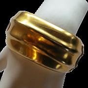 Bold, chunky Essex gold tone hinged bracelet