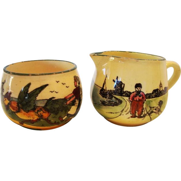 Adorable German / Austrian Earthenware Creamer & Sugar with Hand Painted Dutch Children Playing ~ ZELL UNITED CERAMIC FACTORIES - GEORG SCHMIDER (Germany) - ca 1907 – 1928 / Made in Austria
