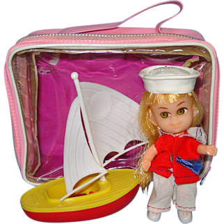 Miniature Doll With Sailboat