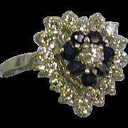Heart shaped 14 Karat White gold lady's 24 stone diamonds, blue sapphires ring size 7