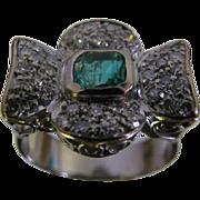 18 Karat Size 6 White Gold Ladies Ring with 38 diamonds/emerald