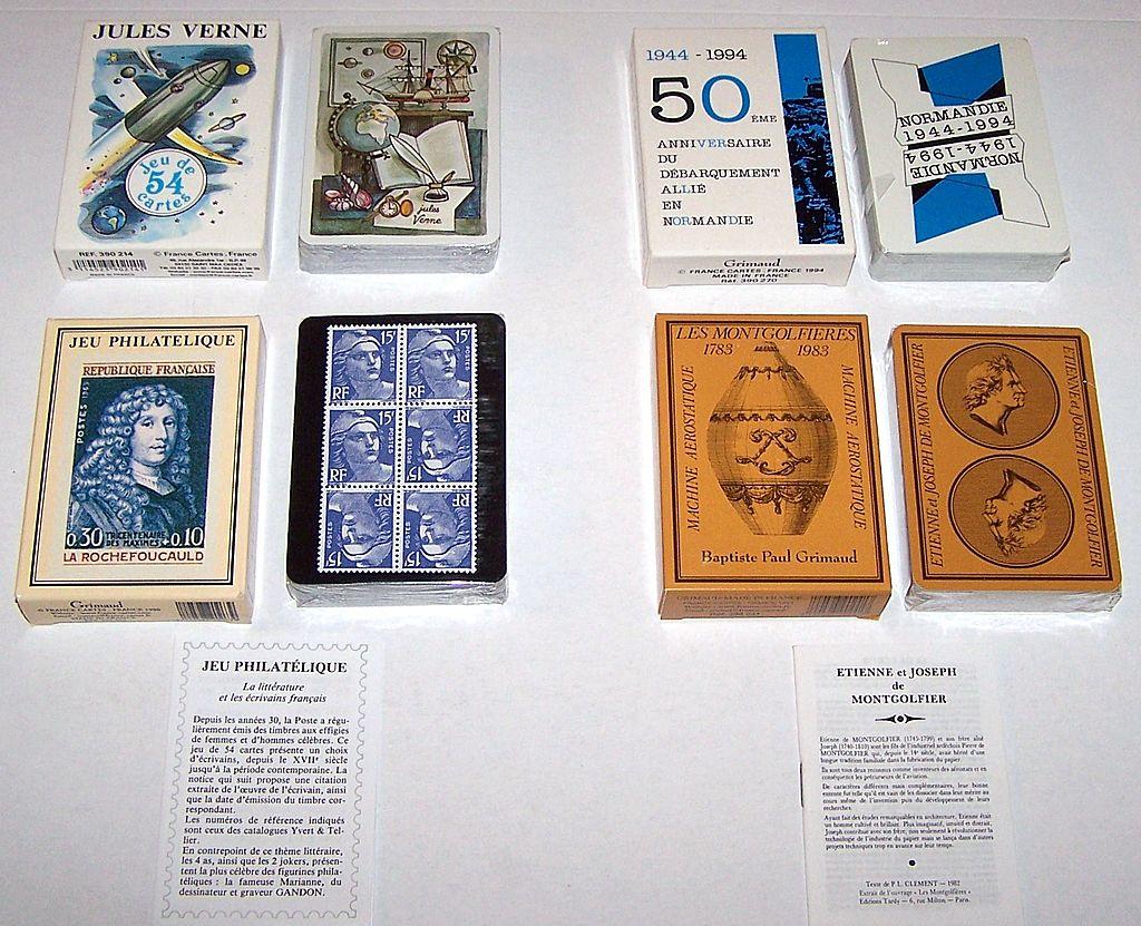 """3 Decks Grimaud Playing Cards, $15/ea.: (i) """"Normandie 1944-1994,"""" Yannick Pennanguer Designs, c.1993; (ii) """"Jeu Philatelique,"""" Jacques Hiver Designs, c.1990; (iii) """"Les Montgolfieres,"""" c.1983"""