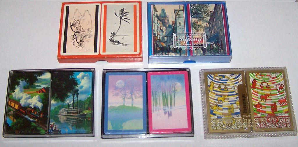"5 Double Decks Various Playing Cards, $10/ea.: (i) Brown & Bigelow (""Archer""), c.1940-1965; (ii) Arrco (""Tiffany""); (iii) Hoyle (""Trump""), Paul Detlefsen Designs; (iv) Hoyle; and (v) Brown & Bigelow (""Stancraft – Elegante"")"